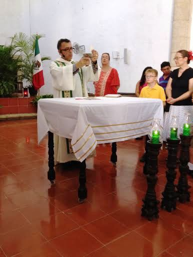 Padre José celebrating the Eucharist