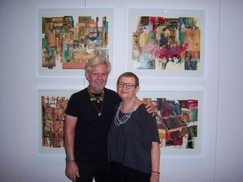 John and Alexandra Wallner in front of the four collages that are part of the current collective exhibition